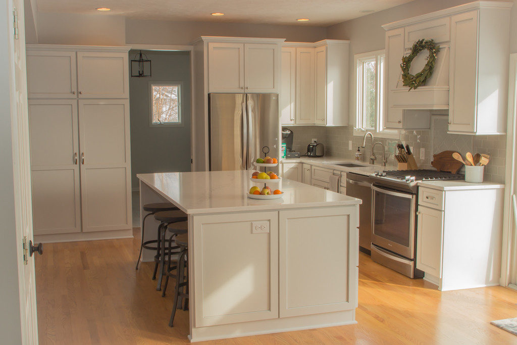 beautiful white renovated kitchen with stainless steel appliances from Nate's Custom Renovations